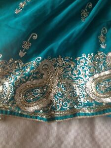 Teal and gold saree with blouse
