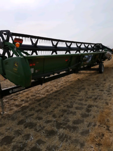 2011 John Deere 635f hydra flex table with transport trailer