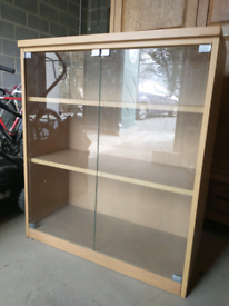 Glass fronted cabinet with shelving