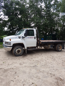 2004 GMC c4500 12 ft deck with goose neck ball
