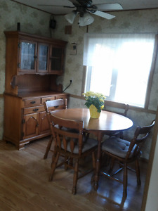 set of table and chairs and china cabinet