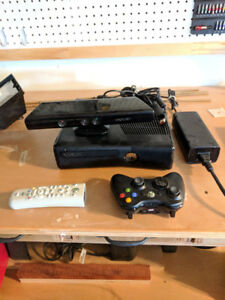 Xbox 360 with Kinect, 1 remote, and a TV remote controller
