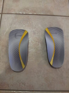 Dr. Scholl' s shoe soles  to help with arch issues.