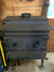 SOLID STEEL WOOD STOVE