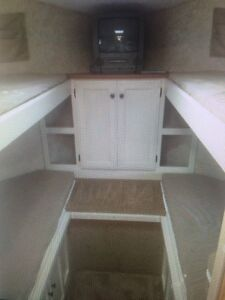 Travel trailer with bunks.