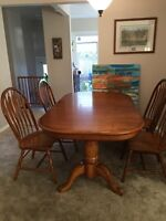 Large solid oak dinning table - $450 (Nanaimo)