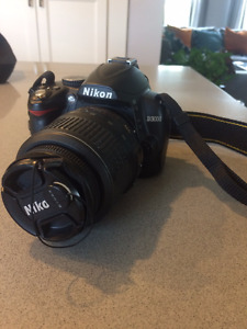 NIKON D3000 + 18-55mm lens + accessories included