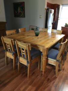 Custom hand crafted pine beetle wood dining table with 8 chairs