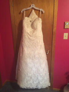 Never worn or altered plus size Alfred Angelo wedding gown.