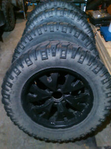 "Mickey Thompson 35"" tires on 20"" rims"