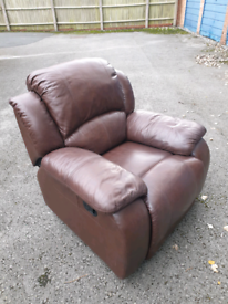 Brown leather reclining armchair in very good condition - can deliver