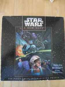 Two STAR WARS Puzzles Plus Collector's Tin