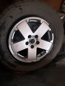 5 tires and jeep rims for  255/70r18