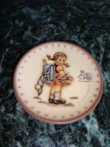 Hummel figurine and small plate