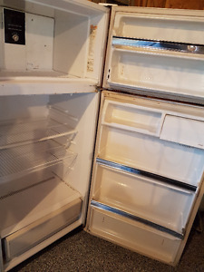 White 18 Cu Ft Gibson Fridge looks and works good.  Approx 8 yea