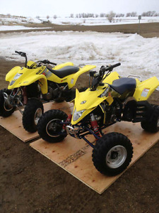 Two suzuki race quads.