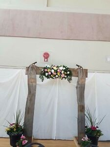 Wooden arch and flower swag