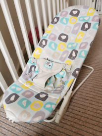 Used mother care bouncy chair with removable cover