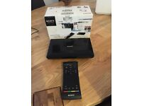 Sony Google TV box with full keyboard and touch sensitive remote.