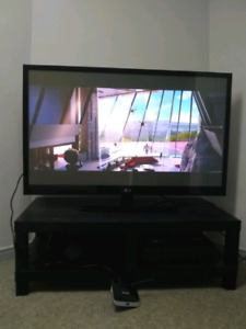 """50"""" LG TV WITH REMOTE CONTROL plus a free android box"""