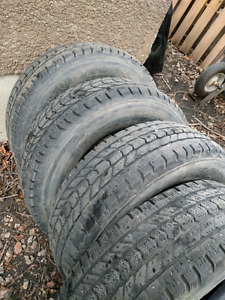 Firestone winter force 275 70r18 studded winter tires.