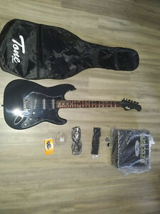 Guitar, amp, whammy bar, pics, extra strings straps, and tuner