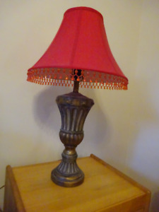 2 matching antique gold lamps with red shades