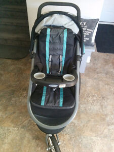 Graco's FastAction Fold Jogger Click Connect Travel Stroller