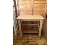 Small, compact desk with storage shelf