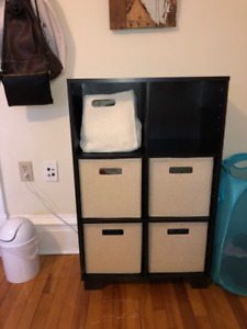 Black 6-cubed shelving unit with inserts.