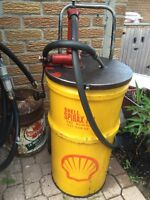 Vintage shell grease/oil can pump and cart