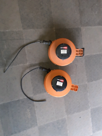 Retractable cable reels.
