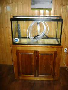Aquarium tank with stand and accessories.