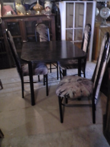 table and 4 chairs/1 leaf $75.