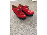 Red faux suede spike creepers