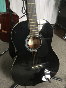 Guitar for sale johnson 3/4 size plays great new strings on it