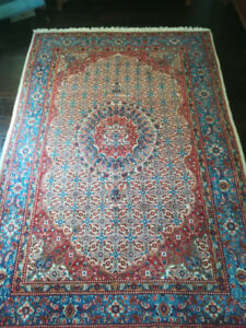 "Iranian handwoven wool carpet 10'3"" x 6'7"". Red, blue ivory, tan"