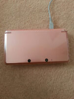 Pink Nintendo 3DS with game