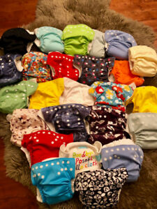 25 cloth diapers in excellent condition + extras