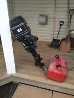 8 hp evinrude wit hose and tank