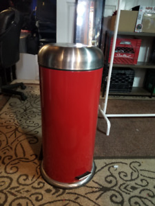 Tall red garbage can
