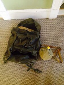 Large Military Back Pack and Canteen. The pack needs cleaned
