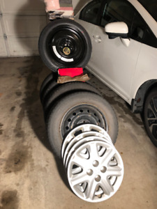 4 - Gislaved Nord Frost 5 Snow tire on rims. 185/65 R15 PLUS