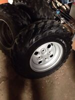 Arctic cat wheel and tires