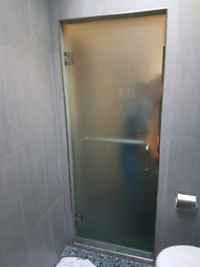Frosted glass shower door.  Never used it