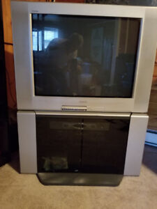 """Free 32"""" Sony Television and stand"""