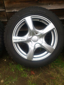Set of 4 winter tires, mounted on rims
