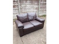 Good condition two seater leather sofa Brown only £55 good bargain call now