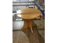 Circular oak table.