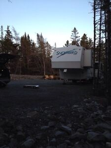 1/2 land for cabin, comes with fifth wheel trailer